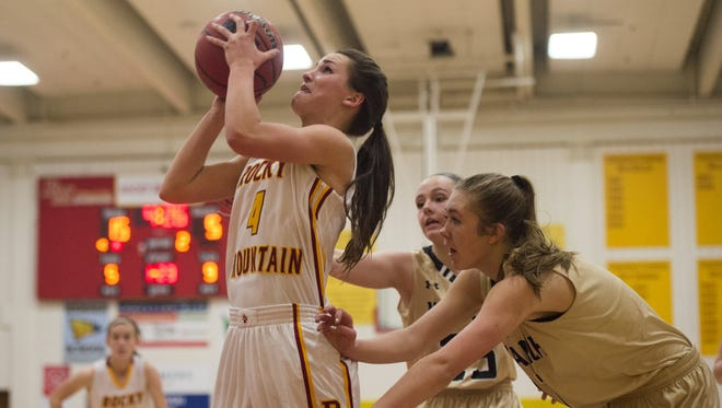 Jade Gosar of Rocky Mountain High School gets around Monarch defense for a two point attempt Friday. The Lobos held off Monarch High School for a 36-33 win.