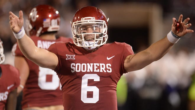 Nov 11, 2017; Norman, OK, USA; Oklahoma Sooners quarterback Baker Mayfield (6) celebrates after a pass for a touchdown against the TCU Horned Frogs during the second quarter at Gaylord Family - Oklahoma Memorial Stadium.