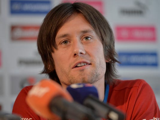 """FILE - In this Thursday, June 6, 2013 file photo, Czech Republic's team captain Tomas Rosicky talks to the media at a press conference in Prague, Czech Republic, ahead of the World Cup group B qualifier soccer match against Italy. Former Czech Republic captain Tomas Rosicky known for his playmaking qualities as """"The Little Mozart"""" announced his retirement from football on Wednesday Dec. 20, 2017. (AP Photo/Martin Meissner, File)"""