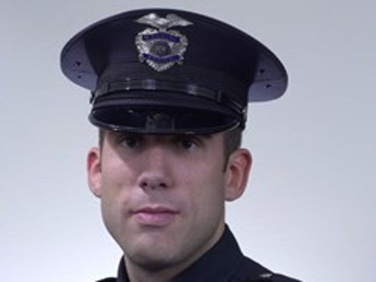 Wyoming police officer Dustin Cook.