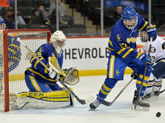 St. Cloud Cathedral defender Max LaBine (17) moves the puck away from goaltender Keegan Karki (35) during the Class A boys hockey state quarterfinals game March 1, 2016, at Xcel Energy Center in St. Paul. Karki, 18, has played the last two seasons in junior hockey.