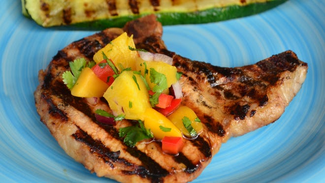 It's hard to resist this Grilled Pork Chop with Pineapple   Mango Salsa which is sweet, salty and smoky. Plus, it's   gorgeous.