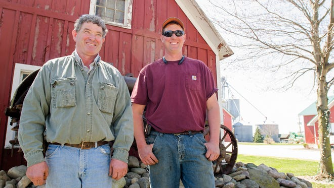 Alvin Ferguson and his son, Jay, Sunday, April 17, at their corn farm in Allenton.