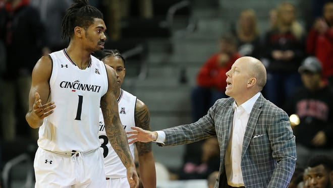 Bearcats head coach Mick Cronin instructs guard Jacob Evans III (1) during the first half of a game against the Mississippi State Bulldogs on Tuesday, Dec. 12, 2017.