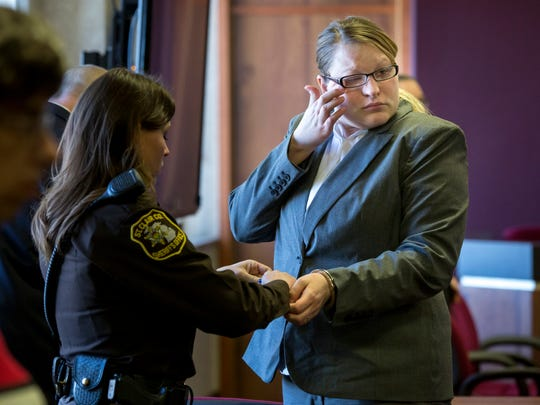 Hilery Maison wipes away a tear as she is handcuffed after being found guilty on all charges Friday, Jan. 30, 2016 at the St. Clair County Courthouse in Port Huron. Hilery and Andrew Maison were found guilty of felony murder in the death of Mackenzie Maison, and first-degree child abuse and torture of Mackenzie and her 3-year-old sister, Makayla.