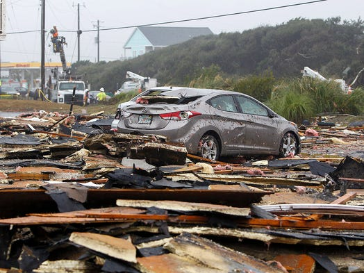 The parking lot of the Ocean Sands Hotel is covered with debris after a major storm struck the area on Nov. 27 in Morehead City, N.C. The city sustained major damage from a late night storm on Nov 26.