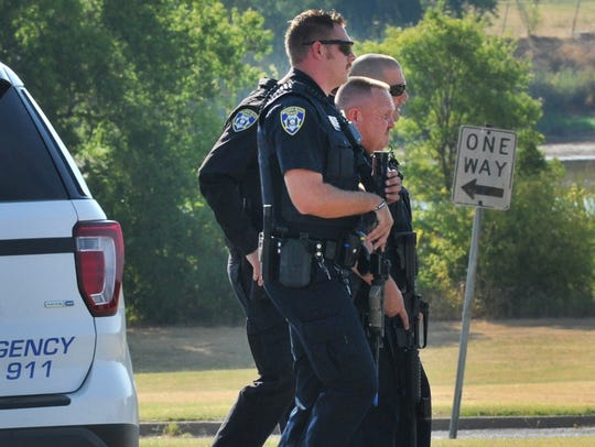 Wichita Falls police officers approach Kirby Middle