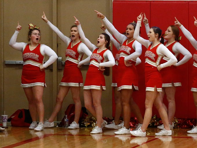 Carlisle cheerleaders lead a chant from the sidelines.