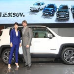 Mike Manley, chief operating officer Asia Pacific and President and CEO Jeep brand, and Daphne Zheng, managing director Chrysler Group China, introduce the all-new Jeep Renegade at the 2014 Beijing Auto Show in China.