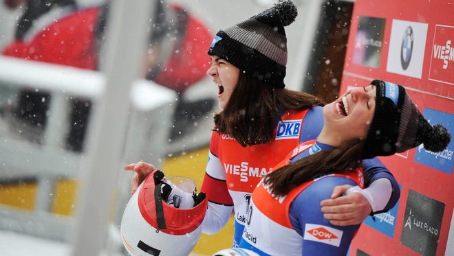 Summer Britcher, left, watches a World Cup luge event in December 2014 with her teammate Emily Sweeney at the Olympic Sports Complex in Lake Placid. Glen Rock's Britcher took fifth in this season's World Cup opener in Austria on Saturday.
