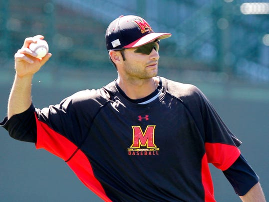 Maryland pitcher Jake Stinnett warms up during practice Friday, June 6, 2014, at Davenport Field in Charlottesville, Va. Maryland faces Virginia in a super regional of the NCAA college baseball tournament on Saturday. (AP Photo/The Daily Progress, Ryan M. Kelly)