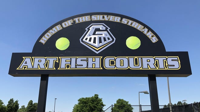 The sign at Galesburg High School's Art Fish Memorial (Tennis) Courts received a new look Tuesday morning, as workers from Fisher Athletics applied a new vinyl wrap to the back and front of the sign.