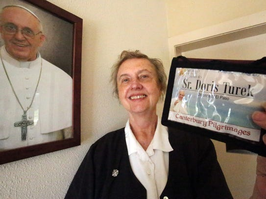 Sister Doris Turek shows the credential she will use