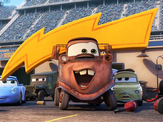 Mater (center, voiced by Larry the Cable Guy) and the gang return in 'Cars 3.'