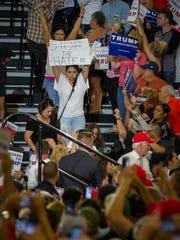 A protestor leaves the Albuquerque Convention Center