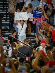 A protestor leaves the Albuquerque Convention Center during a rally featuring presidential candidate Donald Trump, May 24, 2016.