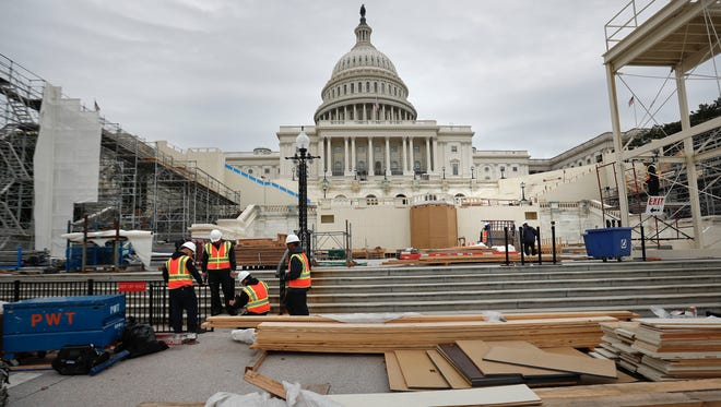 Construction continues on the Inaugural platform in preparation for the Inauguration and swearing-in ceremonies for President-elect Donald Trump, Thursday, Dec. 8, 2016, on the Capitol steps in Washington. Trump will be sworn in a president on Jan. 20, 2017.