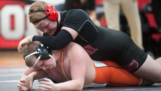 KIngsway's Sean Horner, top, controls Cherokee's Justin Dickinson during the 285 lb. bout of Wednesday's wrestling playoff match held at Kingsway High School.   Horner won by pin.
