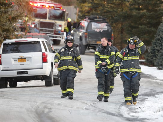 Firefighters at the scene of a fire at the Chappaqua