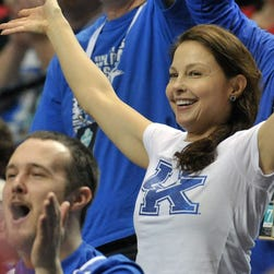 Ashley Judd cheers during the first half of the SEC Conference Championship game between Arkansas Razorbacks and the Kentucky Wildcats.