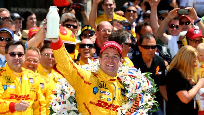 IndyCar Series driver Ryan Hunter-Reay celebrates after winning the 2014 Indianapolis 500 at Indianapolis Motor Speedway.