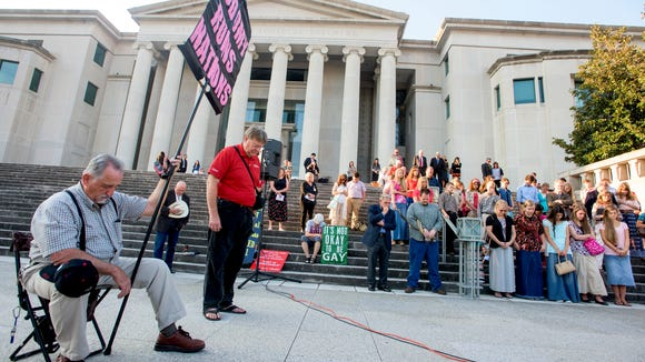 Roy Moore supporters pray on the steps of the Alabama Judicial Building in Montgomery, Ala., before the ethics trial of Alabama Chief Justice Roy Moore on Wednesday September 28, 2016.