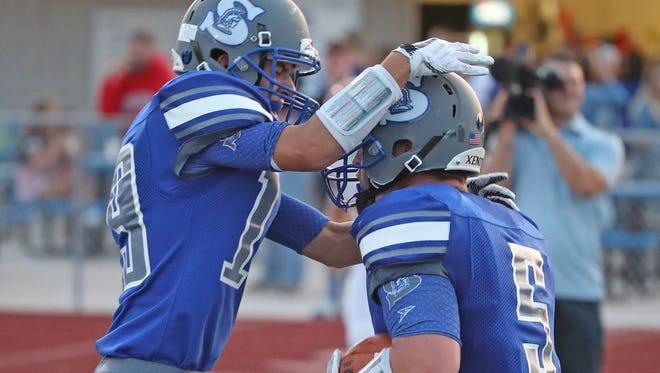 Southwest High School's Noah Schmidt celebrates with Joshua Komis after Komis scored against De Pere High School Thursday, August 24, 2017 at Southwest High School in Green Bay, Wis.