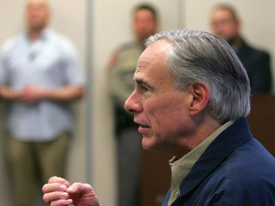 Gov. Greg Abbott talks with Secretary of Homeland Security John Kelly before a briefing on border security Wednesday Feb. 1, 2017 at the Texas Department of Public Safety regional headquarters in Weslaco, Texas. Secretary Kelly and Abbott toured the Texas border with Mexico in a helicopter following the briefing.      (Nathan Lambrecht/The Monitor via AP, Pool)