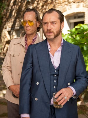 Richard E. Grant (left) and Jude Law in a scene from the film 'Dom Hemingway.'