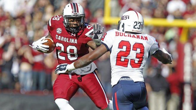 South Carolina running back Mike Davis (28) tries to get past South Alabama safety Roman Buchanan on Nov. 22, 2014.