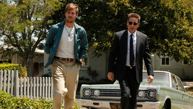 Brian (Grey Damon, left) and Sam (David Duchovny) have differing views of police work in 'Aquarius.'