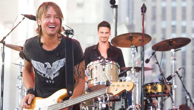 Keith Urban played at CMAC in 2016. He is shown performing in New York City in this 2015 photo.