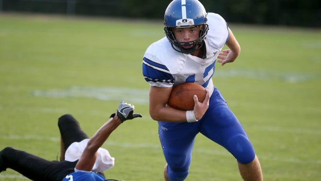 Avery Blocker (12) runs the ball for North Harrison during action between Charlestown and North Harrison at Charlestown High School on Sept. 9, 2016