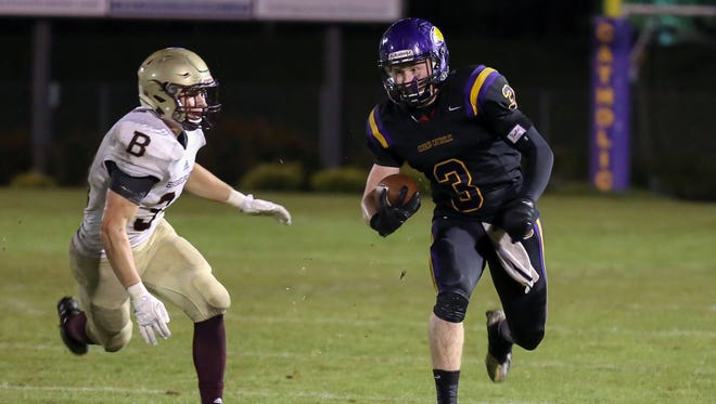 Guerin Catholic's Carter McGinnis ran for 150 yards in the Eagles' 13-10 win over Brebeuf Jesuit Friday.