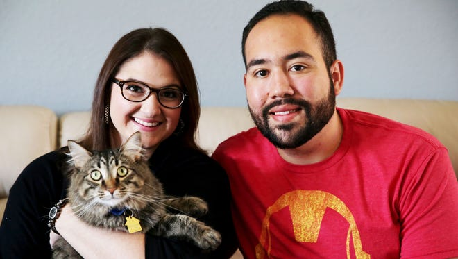 Sheena and Chris Villarraga hold their cat Stark in their Naples home on Thursday, Sept. 29, 2016. Stark is one of 11 pets up for the 2016 Hambone Award, which recognizes the most unusual pet insurance claim.