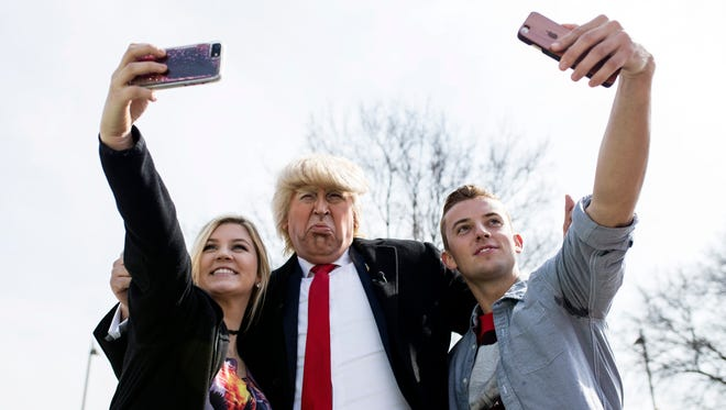 Comedian and Donald Trump impersonator Dustin Gold interacts with Trump supporters before a visit by Pres. Donald Trump to the Kentucky Exposition Center's Freedom Hall on Monday. March 20, 2017