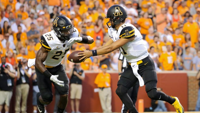 Appalachian State Mountaineers quarterback Taylor Lamb hands off to running back Jalin Moore.