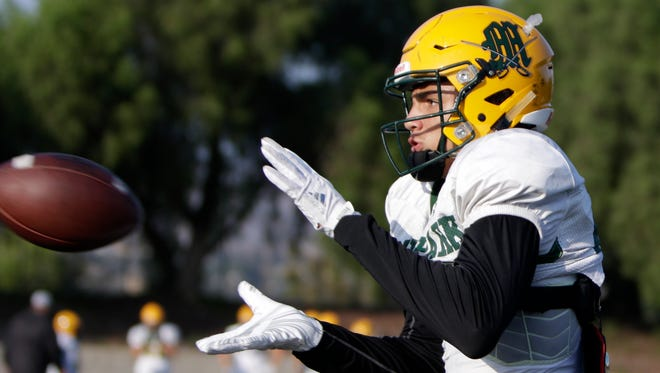 Drake London starred in football and basketball at Moorpark before heading to USC to play both. A new CIF rule could make it harder for high school athletes to play multiple sports.