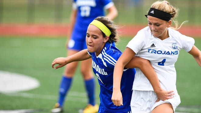 Memorial's Kailyn Stone (8), battling Indianapolis Chatard's Sophie Sergi (4) in the Class 2A semistate, will continue her soccer career at North Alabama, joining Tiger teammate Grace Lensing. They will sign on Wednesday.