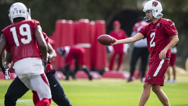 Andy Lee holds a football during a punt drill at practice on Wednesday, Nov. 29, 2017 at the Cardinals Training Facility in Tempe, Ariz.