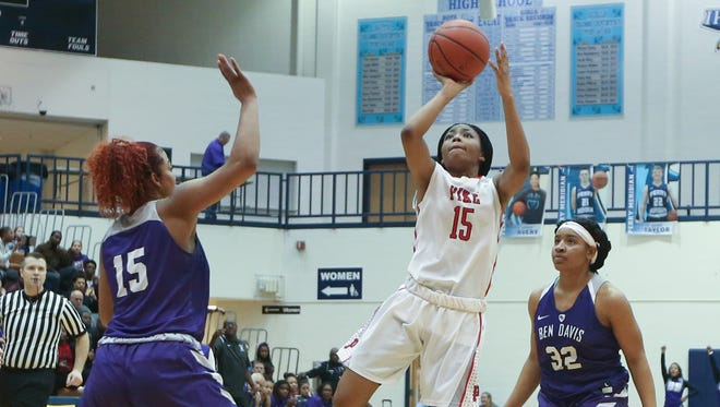 Pike's Angel Baker (15) puts up a shot in the Red Devils' win over Ben Davis on Saturday.