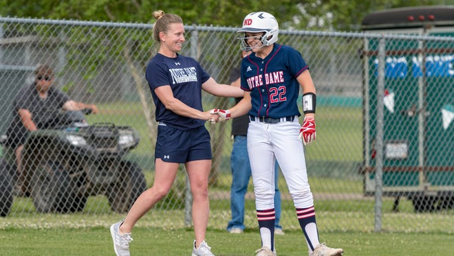 Pios Coach Ashley Ray and Abbey Higginbotham as Notre Dame takes on Kinder. Thursday, April 5, 2018.