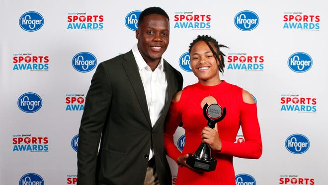 Teddy Bridgewater poses with Kaleb McDonald, winner of the Girls Track and Field Athlete of the Year award, during the 2018 Courier Journal Sports Awards held at The Louisville Palace in downtown Louisville. June 7, 2018