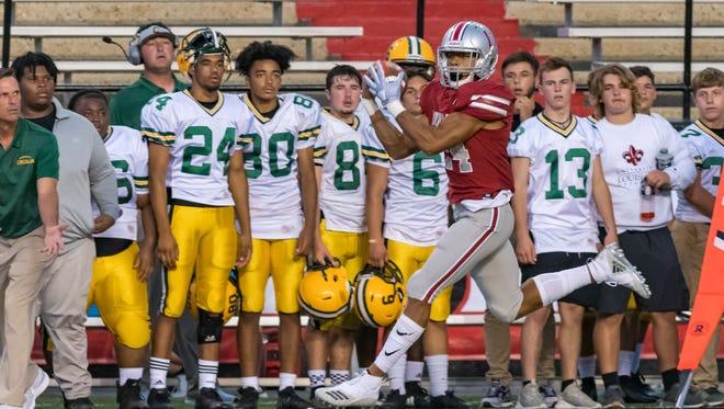 Dunham School's Derek Stingley Jr. makes a catch at the Kiwanis Football Jamboree on Aug. 24 at Cajun Field in Lafayette.