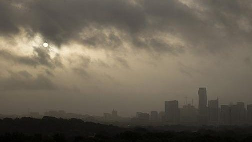 The sun peeks through a large plume of dust from the Saharan Desert in Austin early Saturday morning. The dust decreased visibility to three miles by Saturday afternoon.