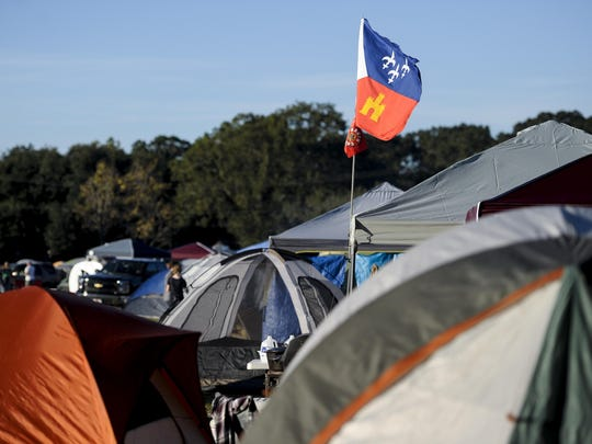 A flag of Acadiana flies over the camping grounds during Blackpot Festival at Acadian Village last year.