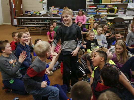 Magee Elementary third-grader Chase Rohrer is cheered