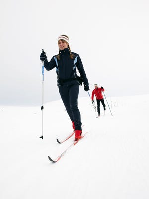 Couple cross-country skiing in snow