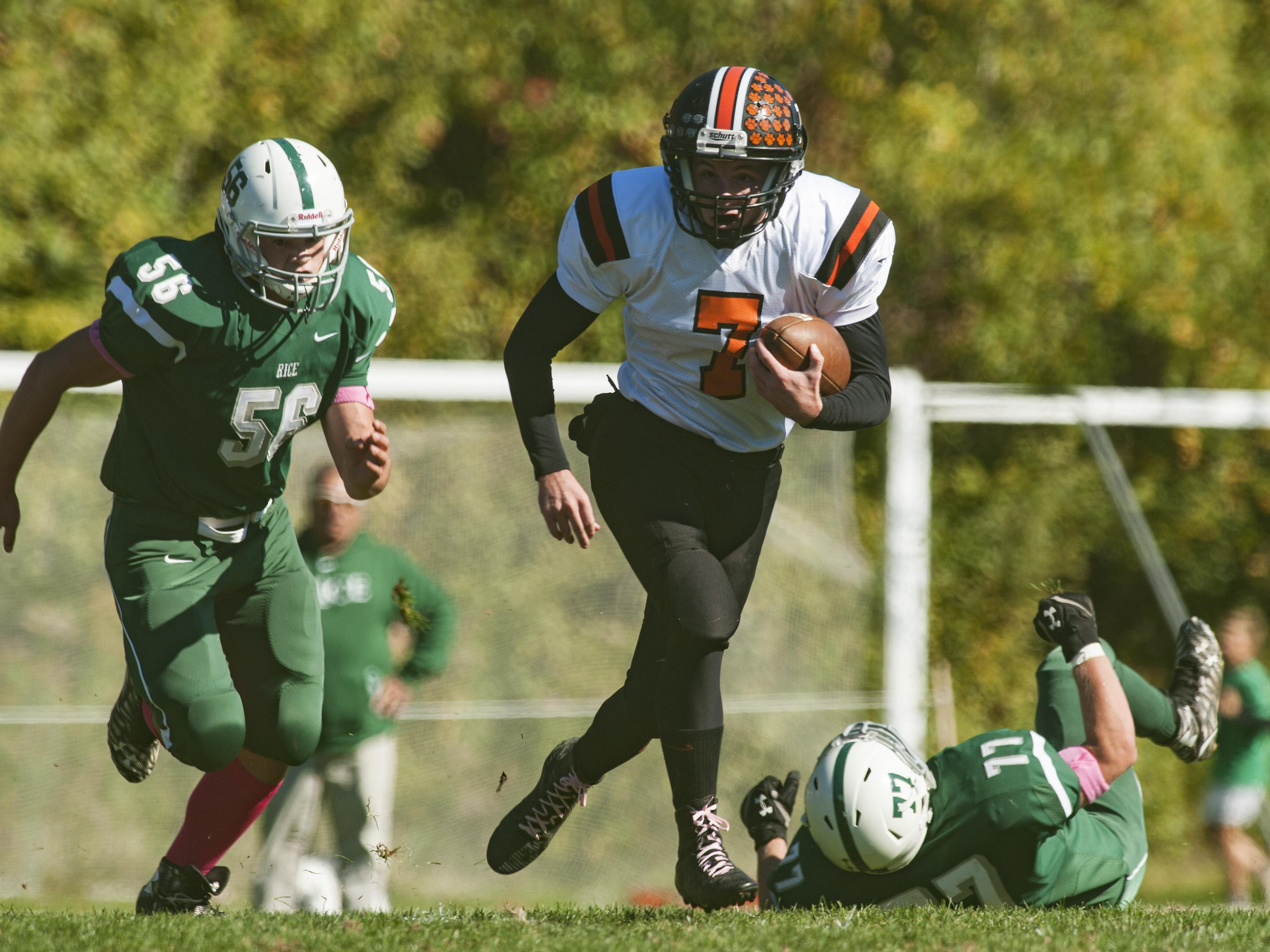 Middlebury quarterback Oakley Gordon (7) runs with the ball during a high school football game Saturday.