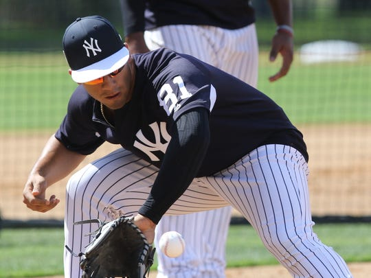 At third base, Gleyber Torres makes a play on a ground ball during defensive drills.
